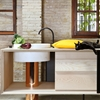"MUT Design uses copper, marble and ash for ""seductive"" freestanding kitchen"