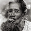 An image from Myanmar. A lovely old woman and her cigar. Gotta...