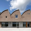 Office with a sawtooth roof pays homage to a Dutch mill by Gerrit Rietveld
