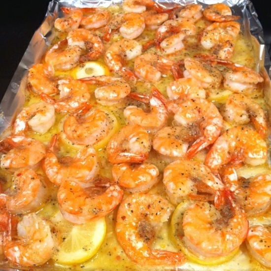 Line baking pan with foil. Cut lemon into slices, put on bottom of pan, drizzle with 1 stick of melted butter. Sprinkle one pack of dried Italian seasoning on raw shrimp and toss. Put raw shrimp on the lemon and butter, then put them in the oven and bake at 350 just till pink (about 10 min)