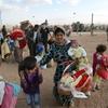 Syrian Kurdish refugees flooding into Turkey