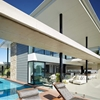 Resort-Style Home in Australia Featuring Wide Overhangs and Entertainment Areas