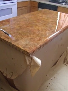 You need to do this in your kitchen to hold you over until the big remodel- Faux granite paint technique for laminate countertops