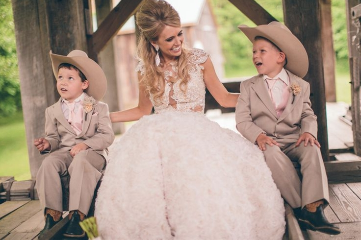We were married at Our Lady of Sorrows church in Valparaiso and to add a bit of country to our ceremony we had the ring bearers in cowboy hats and boots.  We had the flower girls in pink cowboy boots and matching tutus with custom embellished belts.