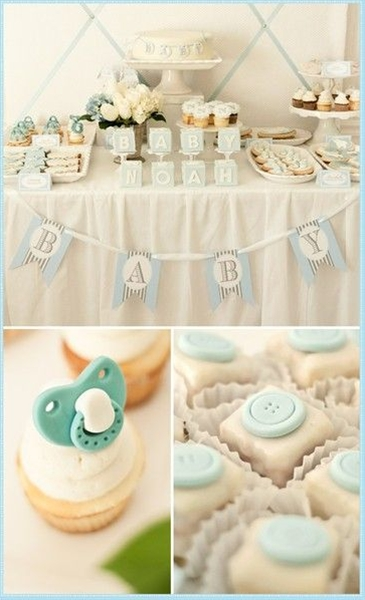 love the table set up, the blue paci in the cupcakes and buttons on petit fours!