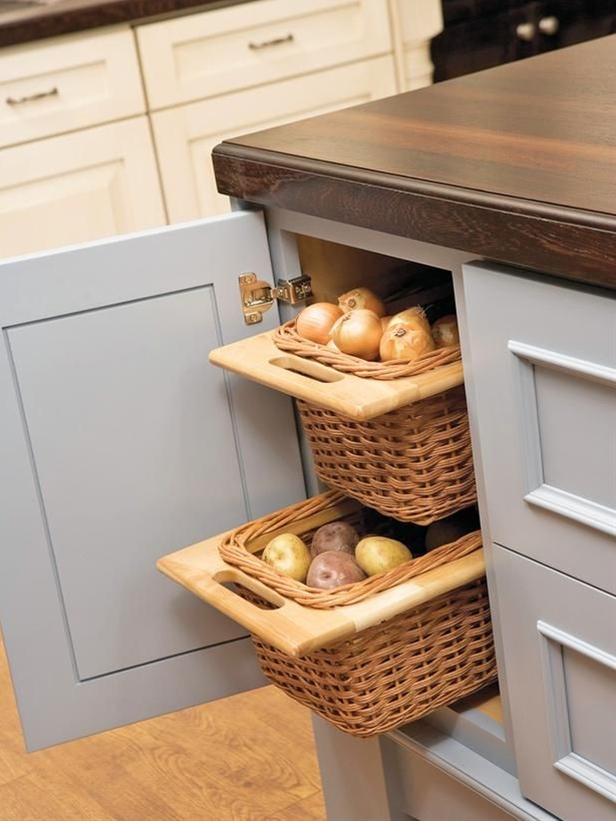 Keep root vegetables, like onions and potatoes, fresh longer by storing them in a cool, dry, dark place. Handy open-weave baskets, like these, provide air circulation to keep the veggies dry while the cabinet's interior protects them from sunlight.