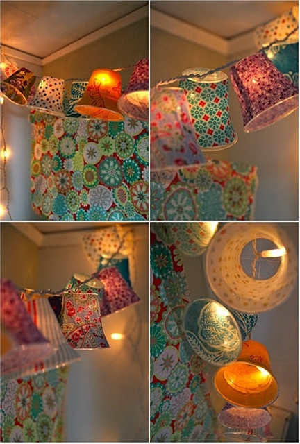 interesting one!   Cover plastic cups in fabric, attach to string lights! Pretty.