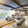 Industrial Home with Interior Planting and Transparent Walls