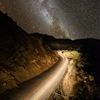 The Milky Way rises above highway 33 north of Ojai,...