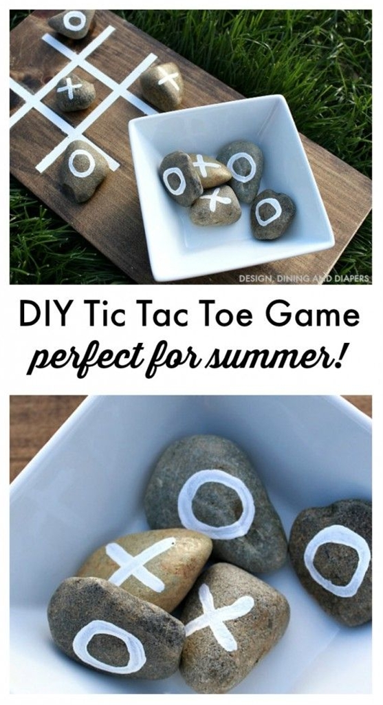"""Keep it in the backyard for BBQ's, bring it camping or simply play a game with the kiddos\n Supplies:\n  – 14x8"""" Board\n  – Dark Walnut Stain\n  – White Paint (both large and small paint brushes)\n  – Wood Sealer\n  – 10 Rocks\n  – Bowl"""