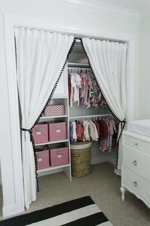 Sweet baby girl's nursery closet design with Ikea curtains replacing closet doors
