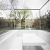 """Gianni Botsford sinks """"invisible"""" extension into the garden of a London house"""