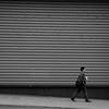 Stranger Walking Across the Street By Straight Horizontal Lines by Jordon Hon