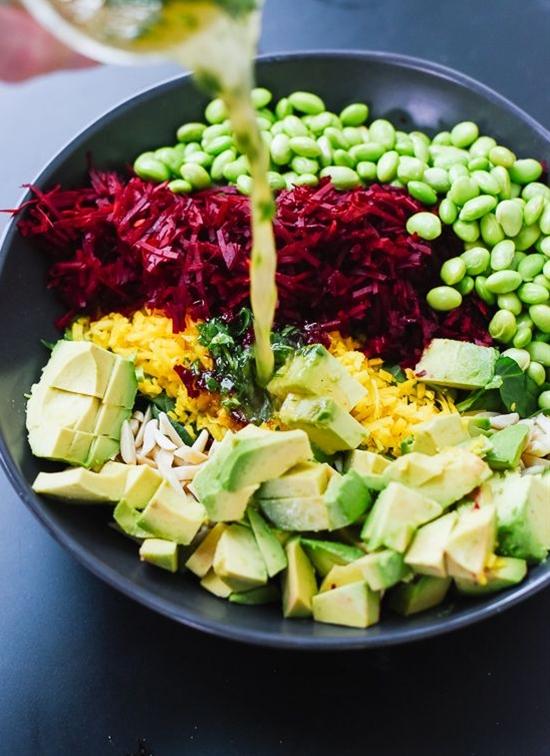 Colorful Beet Salad with Carrot, Quinoa & Spinach\n\n INGREDIENTS\n Salad\n ½ cup uncooked quinoa, rinsed\n 1 cup frozen organic edamame\n ⅓ cup slivered almonds or pepitas (green pumpkin seeds)\n 1 medium raw beet, peeled\n 1 medium-to-large carrot (or 1 additional medium beet), peeled\n 2 cups packed baby spinach or arugula, roughly chopped\n 1 avocado, cubed\n\n Vinaigrette\n 3 tablespoons apple cider vinegar\n 2 tablespoons lime juice\n 2 tablespoons olive oil\n 1 tablespoon chopped fresh mint or cilantro\n 2 tablespoons honey or maple syrup or agave \n nectar\n ½ to 1 teaspoon Dijon mustard, to taste\n ¼ teaspoon salt\n Freshly ground black pepper, to taste