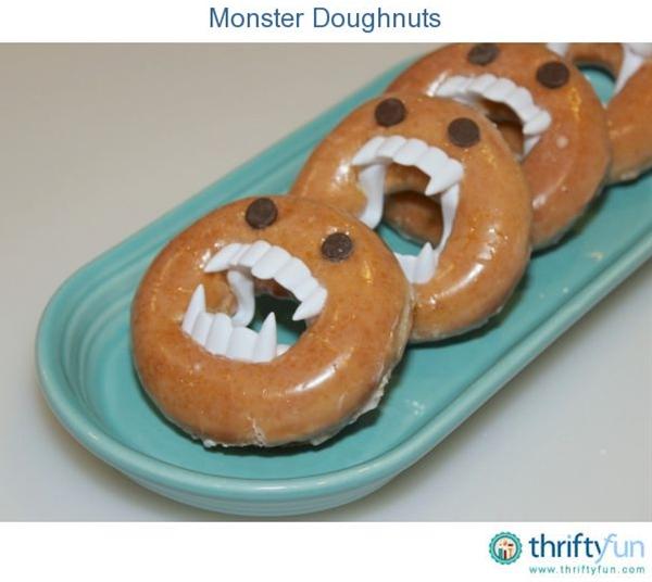 glazed ring doughnuts, plastic vampire teeth, chocolate chips.