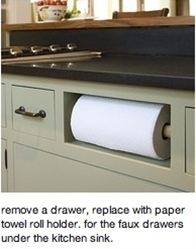I hate that fake drawer thing under the sink.
