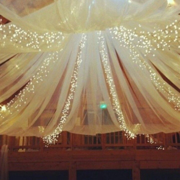 Dance Floor over-head lights. could make this with tulle, lights, and a DIY Portable Pole. For outdoors where there is no cieling