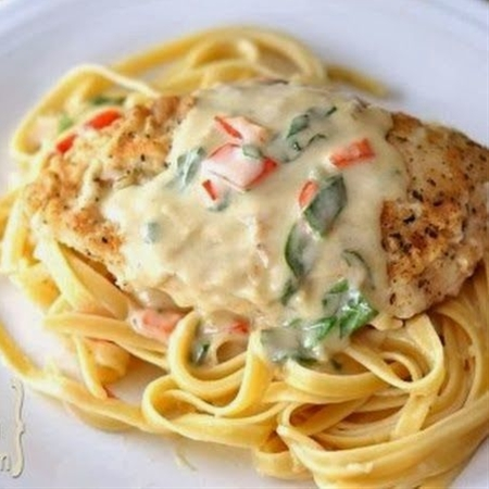 I would order this Tuscan Garlic Chicken every time I went to Olive Garden.  It was my favorite!  And then one sad day I went to order it and they didn't have it anymore.  I felt so lost.  What would I order now?  You can imagine my excitement when I found this delicious copycat recipe.  I absolutely loved it!  I loved that the sauce was thick and savory.  It was so delicious over my chicken and noodles.  It really tasted like the real deal and I am so happy I can make it at home...