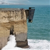 "Vertiginous Cliff House designed to hang off a precipice like ""barnacles clinging to a ship's hull"""