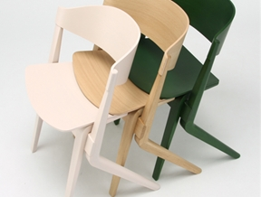 Karimoku New Standard's wooden chairs stack like supermarket trolleys