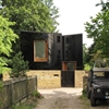 Black glass facade mirrors scenery at south London home by Ian McChesney