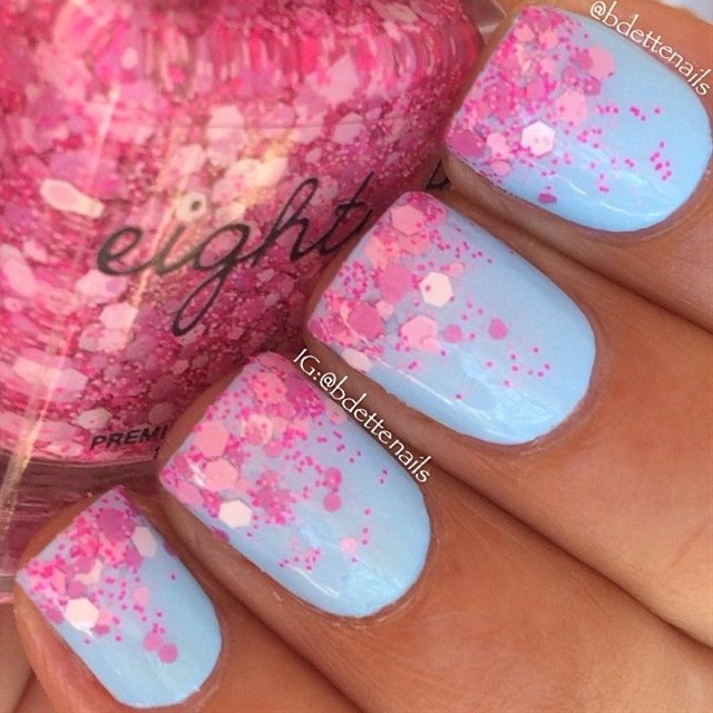 "Here is a glitterbomb gradient using ""Love Dust"" (pink glitterbomb) over ""Powder Puff"" (sky blue creme)"