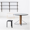 Bouroullec brothers design a bent steel triangle to frame Artek furniture collection