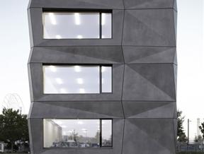 Tillich Architektur adds folded concrete facade to textile company headquarters