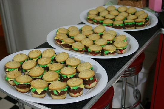 Cute and fun Mini Hamburger cupcakes with real looking cheese. Easy to cook at home for birthday parties or childrens events. Great idea for a Spongebob party by making Krabby Patty burgers or even a 50s diner party theme