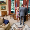 "Kid wins title for ""most bored person to ever meet the President in the Oval Office."""