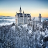 Neuschwanstein Castle at sunset in winter landscape. Germany by Frank Fischbach
