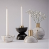 Marble candle holder by Peca can be split to create two objects