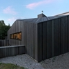 Sustainable L-Shaped Retreat in The Netherlands: The Dockboot Holiday Home