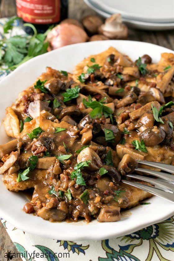 Chicken Marsala - Tender boneless chicken breasts smothered in the perfect salty-sweet Marsala wine sauce with mushrooms and pancetta.  Delicious!