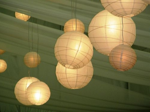 I'm a sucker for paper lanterns, especially those with lights in them. They add such a calming vibe to rooms, and make use of highly-available ceiling real estate. Of course, they are potential fire hazards, and as such, are not allowed in most dorms, so try them without the lights, or see below for some lantern-esque replacements.
