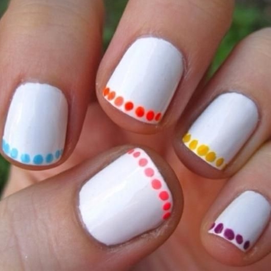White nails are one of summer's biggest trends, and we love the extra pops of neon on this manicure! Coat your nails with a white polish and select accent colors for the tips.