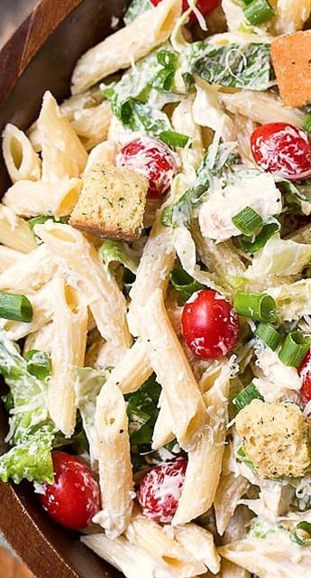 A creamy and delicious pasta salad with all the flavors of a Caesar Salad\n\n Ingredients\n 1 cup mayonnaise\n ⅓ cup sour cream\n 1 large clove garlic, pressed\n 2 tablespoons lemon juice\n 2 anchovies, finely minced\n 1 teaspoon Worcestershire sauce\n 1 pound penne pasta, cooked until al dente and rinsed with cool water\n 6 large leaves Romaine lettuce, thinly sliced\n 1½ cups grape tomatoes\n 4 green onions. green parts sliced\n ½ cup finely shredded Parmesan cheese\n ½ teaspoon ground black pepper\n 2 grilled chicken breasts, diced\n 1½ cups croutons