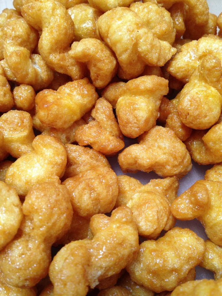 I make this all the time and it's always a hit!\n \n  Ingredients:\n   1 8oz bag of puffcorn(this stuff is also delicious on it's own, but that's beside the point)\n  1/2 lb (2 sticks) butter\n  1 cup brown sugar\n  1/2 cup light corn syrup\n  1 tsp baking soda