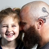 Dad gets world's least embarrassing head tattoo to match his daughter's cochlear implant.