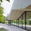 Frei + Saarinen adds a zigzagging roof to a community centre extension in Switzerland