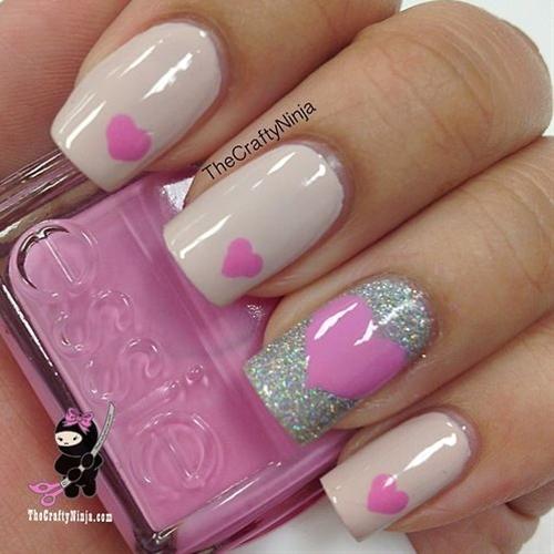 Pink and glitter heart nail art.