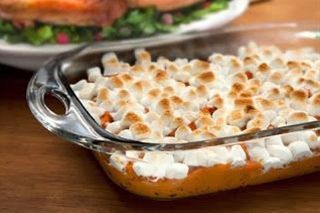 Ingredients: 1 (40 oz) can of Bruce's cut yams, drained,  ½ cup brown sugar,  ½ teaspoon cinnamon,  ¼ teaspoon salt,  1 egg, beaten,  4 tablespoons melted butter,  1 (16 oz) bag of miniature marshmallows.