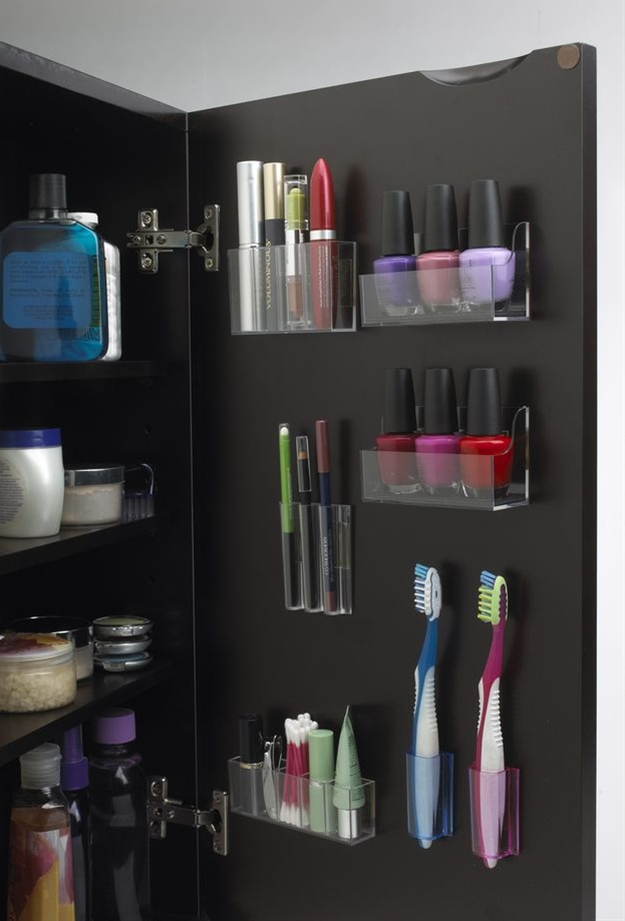 When you only have one cabinet, you have to maximize that tiny space. These StickOnPods hold tiny things like nail polish. Lazy susans let you reach the stuff in the back of your cabinet as easily as you can reach the stuff in the front.