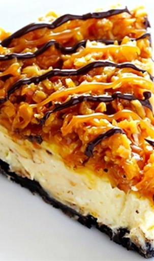 It's a simple vanilla cheesecake base, made with an Oreo crust, and topped with caramel, toasted coconut and drizzled with chocolate... Fabulous!\n\n INGREDIENTS:  CHEESECAKE INGREDIENTS:\n  24 Oreo cookies\n 4 Tablespoons melted butter\n pinch of salt\n 3 (8-ounce) bricks neufchatel (low-fat) cream cheese, softened\n 1 cup granulated sugar\n 1 cup plain or vanilla Greek yogurt\n 2 tsp. vanilla extract\n 3 eggs\n\n SAMOA TOPPING INGREDIENTS:\n  2 cups shredded sweetened coconut\n 1 3/4 cups caramel dip or sauce (you can either buy the 16-ounce store-bought tubs of caramel dip, or use 1 3/4 cups homemade caramel sauce