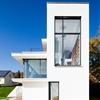 Philipp Architekten's all-white House M frames a sunken swimming pool
