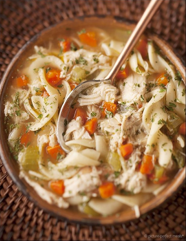 Ingredients:  2 tablespoons unsalted butter,  2 tablespoons extra-virgin olive oil,  1 onion, peeled and diced,  4 celery stalks, small-diced,  4 carrots, peeled and small-diced,  1 teaspoon minced garlic,  2 bay leaves,  Kosher salt and freshly ground black pepper,  2 quarts chicken stock or broth,  3 cups cooked chicken, shredded or diced,  2 cups wide egg noodles.