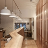 London cafe interior by TwistInArchitecture references city's commercial history