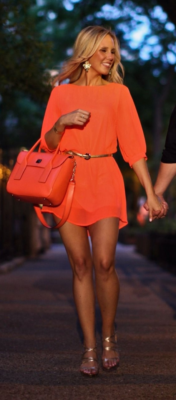Love the bright orange with the nice summer tan!