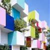 Coloured boxes and plants cover the latest Sugamo Shinkin Bank by Emmanuelle Moureaux
