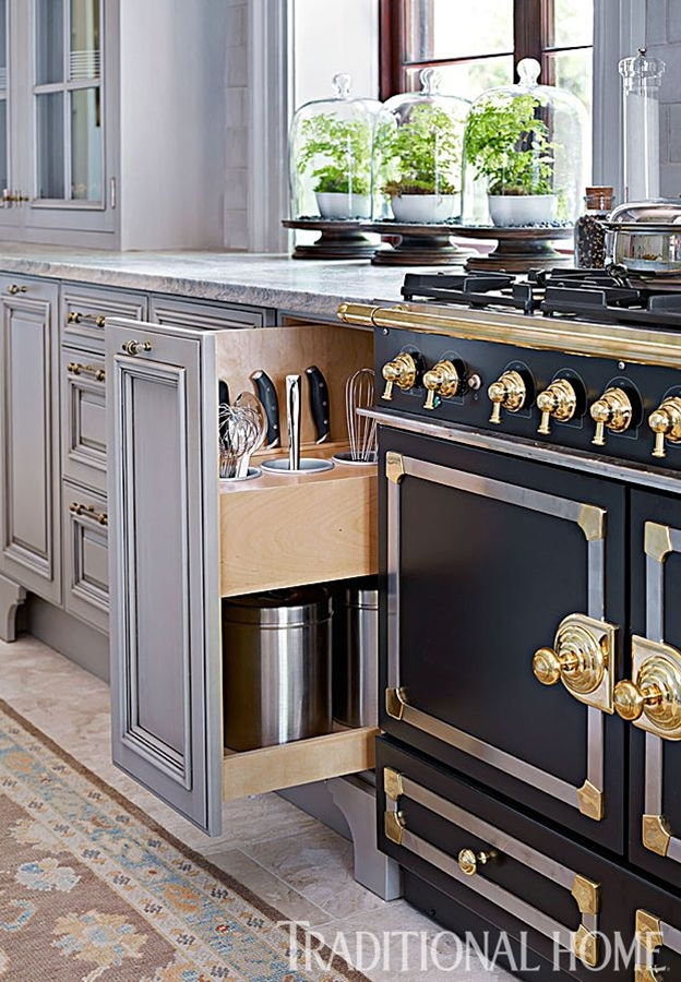 A pullout with drop-in bins keeps spoons, whisks, and other utensils handy. - Photo: Emily Jenkins Followill / Design: Matthew Quinn
